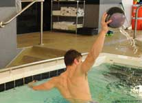 patient in pool with ball