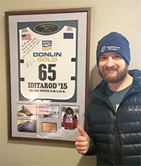 Musher Wade Marrs pictured with 2015 Iditarod bib